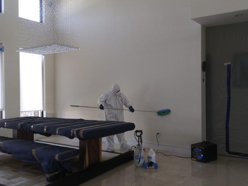A technician cleans walls wear viruses can hide.
