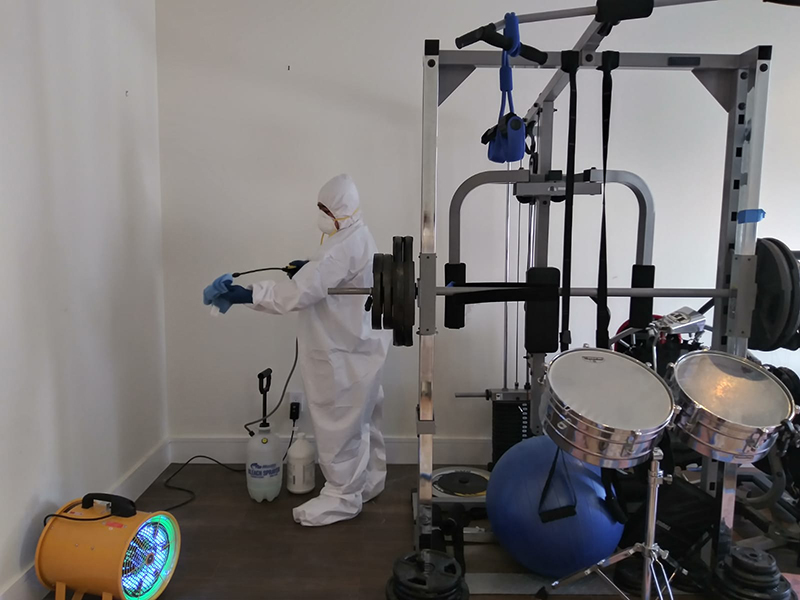 A technician disinfects a home gym from viruses and harmful bacteria.