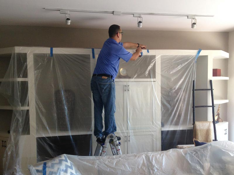 A CleanPro employee covers the home to protect it from the restoration process.